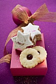 Cinnamon stars and jam biscuits on pink box
