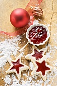 Star-shaped biscuits with raspberry jam