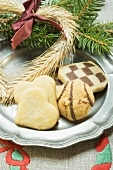 Assorted Christmas biscuits on pewter plate