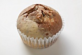 One chocolate and vanilla muffin in a paper case