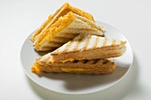 Several toasted cheese sandwiches on plate
