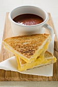 Toasted cheese sandwiches & a cup of tomato soup on board