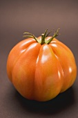 Tomato on brown background
