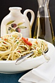 Spaghetti with chillies and herbs, olive oil