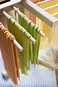 Home-made ribbon pasta, hanging up to dry