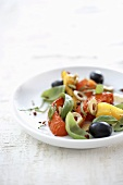 Pepper salad with olives and basil