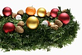 Christmas arrangement of fir sprigs, baubles and nuts