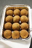 Falafel (chick-pea balls) in aluminium container