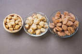 Assorted nuts to nibble in bowls