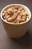 Mixed nuts to nibble in brown pot