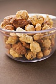 Mixed nuts to nibble in glass bowl