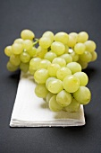 Green grapes on linen cloth