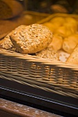 Assorted bread rolls in a basket at a market
