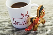 Gingerbread horse and cup of cocoa
