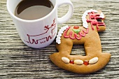 Gingerbread rocking horse and cup of cocoa