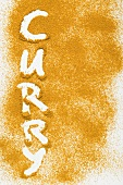 The word 'Curry' written in curry powder