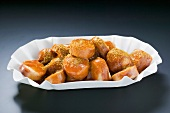 Currywurst (sausage with ketchup & curry powder) in paper dish