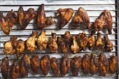 Grilled chicken wings on rack