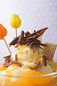 Fruity ice cream sundae with apricots & chocolate shavings