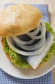 Bread roll filled with herring and onions