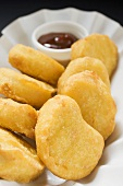 Chicken nuggets with dip in paper dish