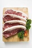 Sirloin steaks on chopping board