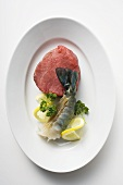 Beef fillet and king prawn with parsley and lemon