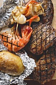 Surf and Turf (beef steaks and prawns) with baked potato