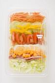 Iceberg lettuce, ham, cheese, egg & vegetables in plastic tray