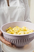 Serving bowl of cooked tortellini