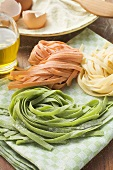 Home-made ribbon pasta, ingredients in background