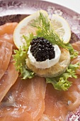 Smoked salmon with caviar and sour cream canapé