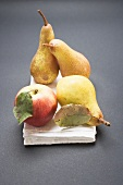 Three pears and an apple on cloth