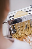 Making home-made linguine with a pasta maker