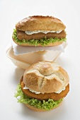 Two schnitzel rolls with remoulade and lettuce