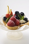 Assorted fruit tarts on cake stand