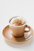 Cup of cappuccino with milk froth and cocoa powder