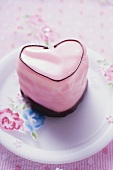 Pink heart-shaped petit four on plate