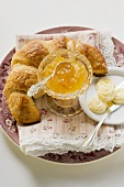 Orange marmalade, croissant and butter
