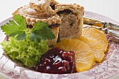 Meat pie with oranges and cranberries