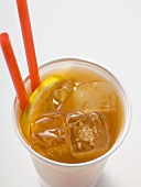 Iced tea with lemon and straws in plastic cup
