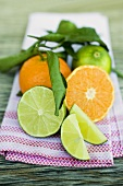Clementines and limes with leaves