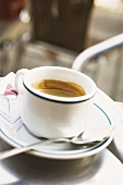 Cup of espresso on table in café