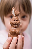 Child holding chocolate Easter Bunny