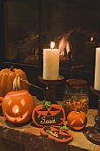 Halloween decorations (pumpkin lanterns, candles, place cards)