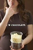 Woman eating chocolate chips