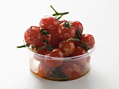 Roasted cherry tomatoes in plastic container
