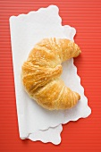 Croissant on paper napkin (overhead view)