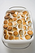Sweet potato and marshmallow gratin in baking dish