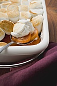 Sweet potato & marshmallow gratin in baking dish with spoon